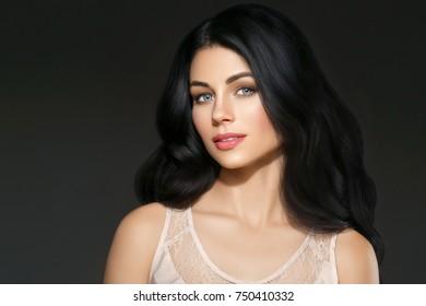 Beautiful woman face studio portrait. Beauty black long hair. Studio shot.