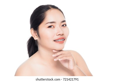Beautiful woman face with teeth brace dental close up portrait studio on white background