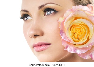 beautiful woman face and tender rose
