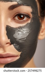 Beautiful woman with facial mask.