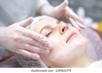 Beautiful woman with a facial mask at a beauty salon