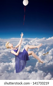 Beautiful woman falling down from the sky