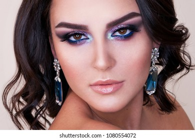 Beautiful woman with fashion make-up. Fashion Brunette Model Portrait. Hairstyle. Haircut. Professional Makeup.
