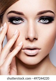 Beautiful woman with fashion makeup of eyes.  Long black eyelashes.  Closeup. Black long eyelash.