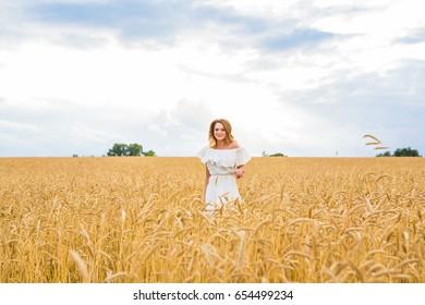 Beautiful woman in a field