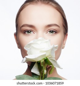 Beautiful Woman with Flower. Beauty Portrait of girl with White Rose Flower. Clean Face, care