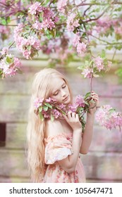 Beautiful woman with flowering tree