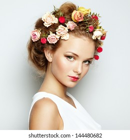 Beautiful woman with flowers. Perfect face skin. Beauty Portrait. Fashion photo