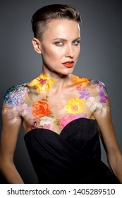 Beautiful woman with flowers tattoos on body, elegant style, party look