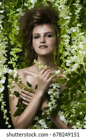 beautiful woman in flowers.fashion art photo of perfect body model girl with make-up and hairstyle.spring lady plant