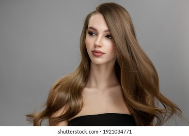 Beautiful woman with flying hair. Long hair hairstyle and makeup