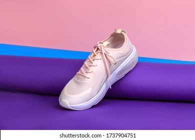 Beautiful woman foorwear. Creative design concept. Tender pink color shoe with laces.