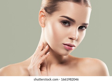 Beautiful woman fresh clean skin natural make up green background