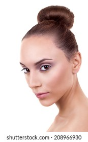 Beautiful woman with fresh clear nude skin and daily natural face makeup on white. Skin care and spa. Fashion hairstyle.