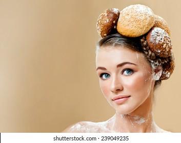 Beautiful woman with fresh fragrant bread. Crispy rolls. Bread Baking.