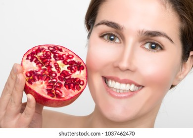 Beautiful Woman with fresh Pomegranate
