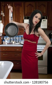 Beautiful woman with a frying pan who doesn't want to cook