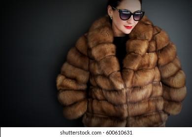 A beautiful woman in a fur coat