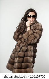 beautiful woman in a fur coat fashion