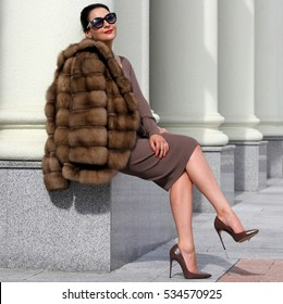 A beautiful woman in a fur coat. Fashion and beauty