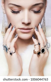 beautiful woman in fur and jewelry.beauty and fashion girl, make-up and manicure