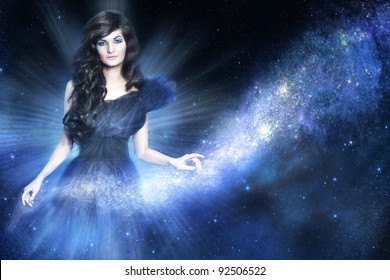Beautiful woman as galaxy godness holding a milky way on blue background