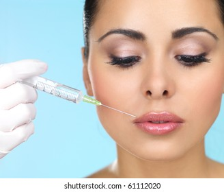 Beautiful woman gets injection in her face