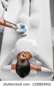 Beautiful woman getting beauty therapy against cellulite with LPG machine on her butt. LPG massage for lifting body, view from above