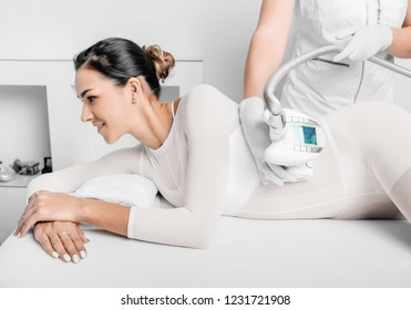 Beautiful woman getting beauty therapy against cellulite with LPG machine on her butt. LPG massage for lifting body