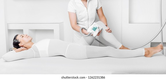 Beautiful woman getting beauty therapy against cellulite with LPG machine on body. LPG massage for lifting body