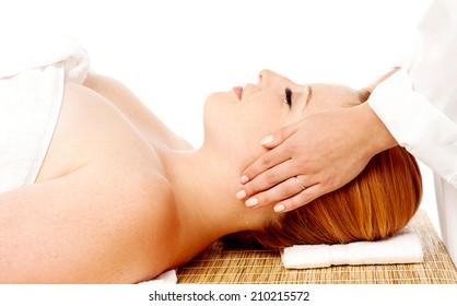 Beautiful woman getting a face treatment at beauty salon