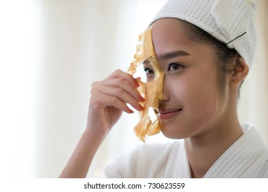 Beautiful woman getting facial mask at beauty salon.