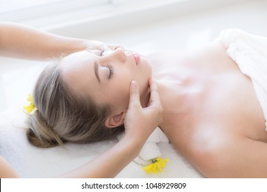 Beautiful woman getting facial massage in spa salon , Health and beauty concepts