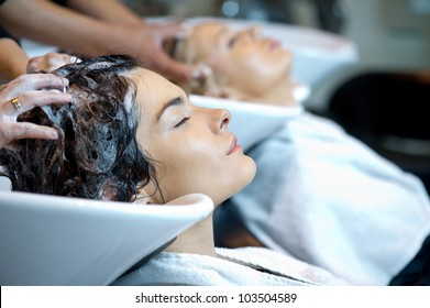 Beautiful woman getting a hair wash. In a hair salon