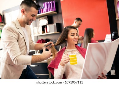 Beautiful woman getting haircut by hairdresser, relax at beauty salon while drinking coffee