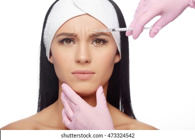 Beautiful woman getting lifting injection in forehead. Close-up woman hyaluronic acid injection. Botox Injections of skin rejuvenation. Cosmetic procedures, botox injections, hyaluronic acid.