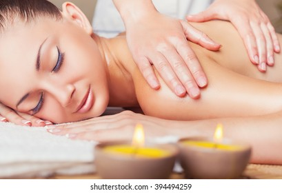 Beautiful woman getting a massage in the spa salon