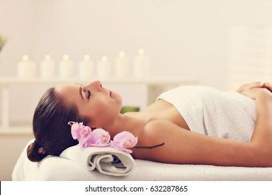 Beautiful woman getting massage in spa
