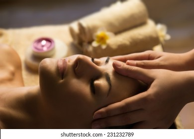 Beautiful woman getting spa treatment. Facial massage