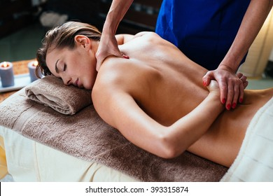 Beautiful woman getting thai massage in spa