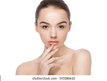 Beautiful woman girl natural makeup spa skin care portrait holding arm next to chin on white background