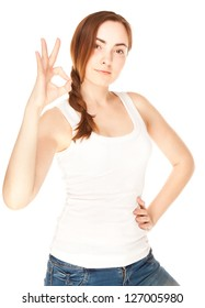 Beautiful woman giving okay sign isolated on white