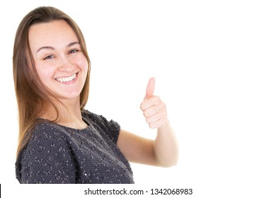 Beautiful woman giving thumbs up over white background copy space
