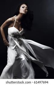 Beautiful woman in glamour evening dress