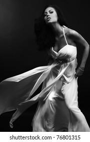 Beautiful woman in glamour evening dress. Black-white photo.