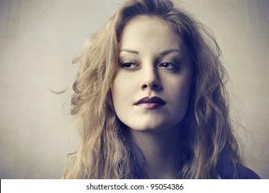 Beautiful woman glancing sideways at something