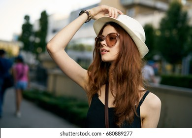 Beautiful woman in glasses and hat portrait