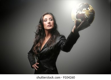 A beautiful woman with a globe
