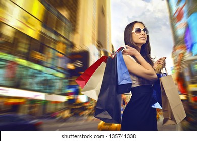 beautiful woman goes shopping in the city