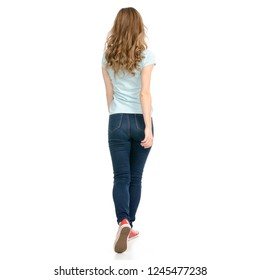 Beautiful woman goes walking showing of positive emotions happy on a white background. Isolation  back view